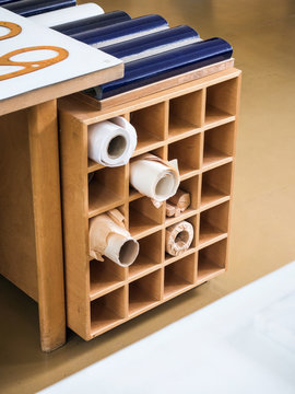 Square wooden rack with rolled paper