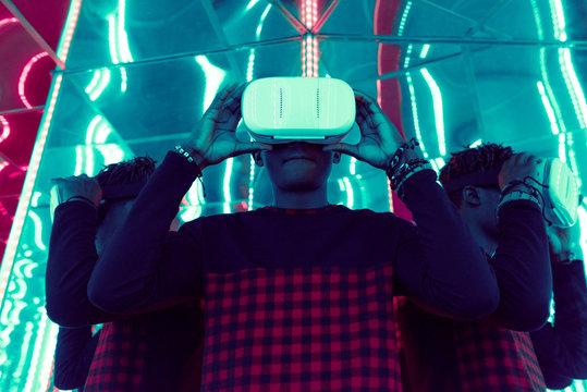 Ethnic man in VR headset in mirror maze
