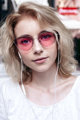 Summer street fashion closeup portrait of young beautiful and sensual blonde girl