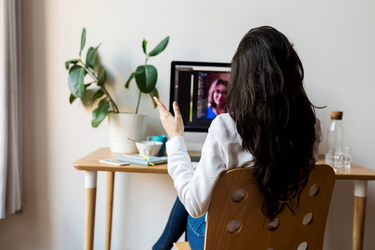 young Business woman Has Video Call On home office