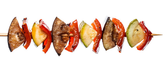 Grilled vegetable kebab on skewer with tomato, pepper, zucchini, squash and eggplant on white background, isolated food.
