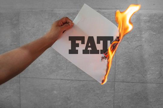 Burn fat text on burning paper