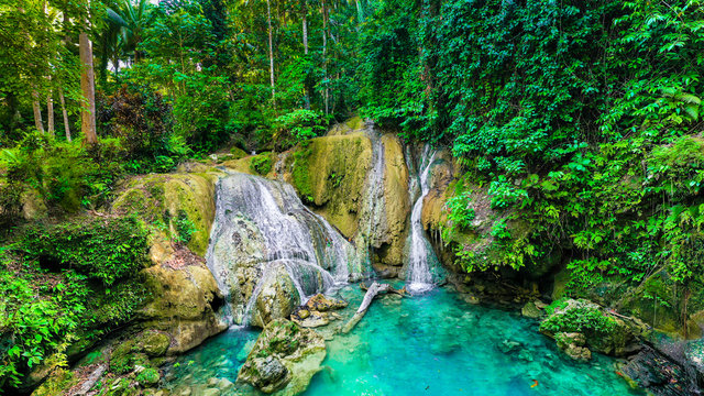 A tropical jungle waterfall in the hidden slopes of one the most beautiful islands in the Philippines.  The Island of Bohol.