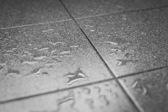 Water drops on the tile floor