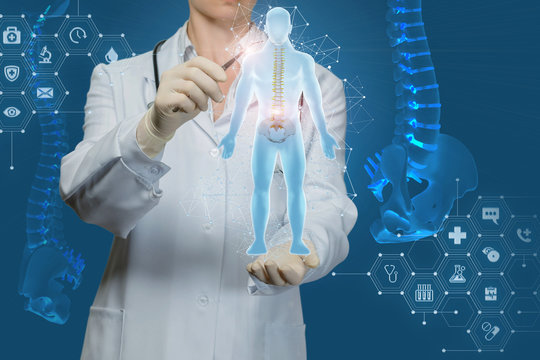 Worker of medicine examines the human spine .
