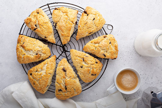 Homemade chocolate chunk scones with coffee for breakfast
