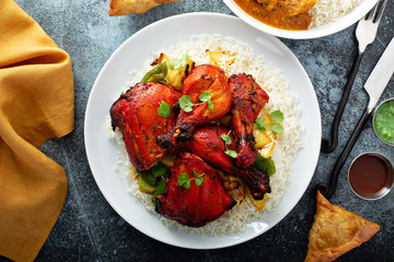 Whole tandoori chicken with jasmine rice, indian food