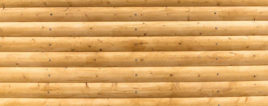 The logs are bright yellow. Wooden plank background