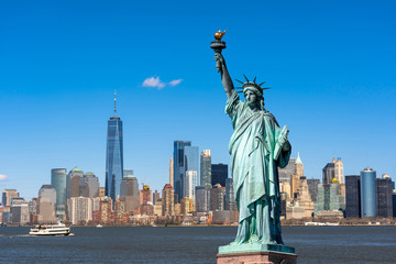 Foto auf Leinwand New York The Statue of Liberty over the Scene of New york cityscape river side which location is lower manhattan,Architecture and building with tourist concept