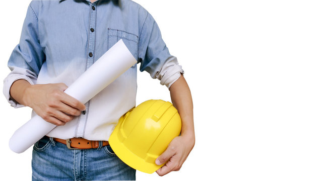 No face Unrecognizable person. Torso engineer, worker or architect holding in hand blueprint and yellow plastic helmet, hardhat isolated on white background