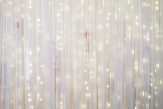 White curtain backdrop with small LED lights decoration