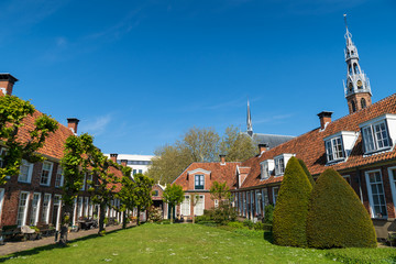Sint Anthony Gasthuis with old almshouses around a small, public courtyard  in the Dutch city of Groningen. Netherlands