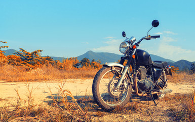 Aged motorbike under sky with digital color picture photo effect