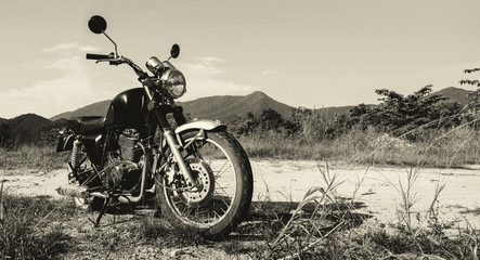 Motorbike on the road under sky