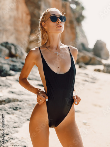 66a39d707d Attractive young woman in bikini relax at tropical beach in Bali. Model  with ocean