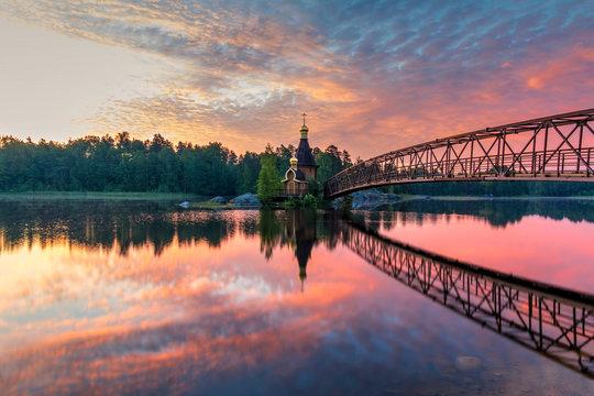 Church of Andrew on the River Vuoksa. Beautiful summer sunrise. Leningrad Oblast, Russia