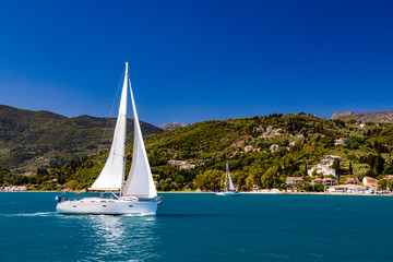 Lonely yacht sailing on silent sea. Turkey. Wall mural