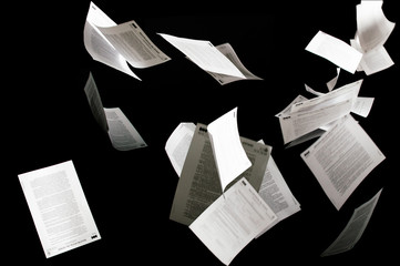 Many flying business documents isolated on black background Fototapete