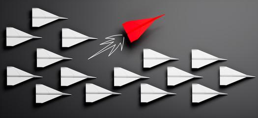 Gruppe weißer Papierflieger mit rotem Leader 2