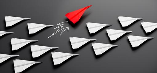Gruppe weißer Papierflieger mit rotem Leader