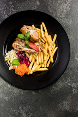 Chicken wraps with fries and salad, restaurant serving portion