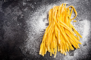 Yellow egg homemade raw tagliatelle pasta