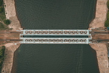 Steel Railroad Bridge with Rails over River, Aerial Drone View, Wall mural