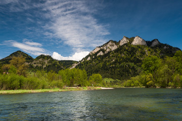 Three Crowns or Trzy Korony mountain peak over Dunajec river in Poland