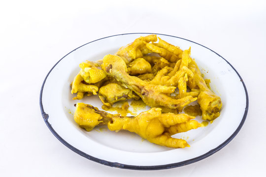 Deep fried chicken feet is a traditional South African township food snack image with copy space