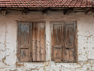 Old Style Brownish Wooden House of the Mud Windows
