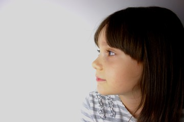 portrait of 8 years old girl looking at her right