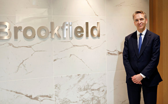 Bruce Flatt, CEO of Brookfield Asset Management, poses in front of the company's logo in Tokyo