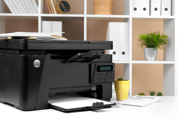 Printer, copier, scanner in office. Workplace.