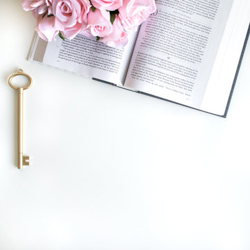 lifestyle flat lay with different accessories; flower bouquet, pink roses, open book, Bible, pen, journal, etc. Basel Land, Switzerland - April 12, 2019