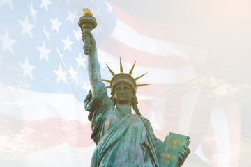 Image of double exposure statue of liberty and USA flag. Background for Independence day or Memorial day.