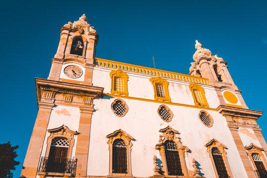 majestic church in the heart of faro with darken sky