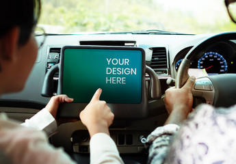 Couple Using Tablet Display Mockup in a Car