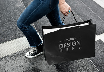 Person Holding Paper Bag Design Mockup on Street