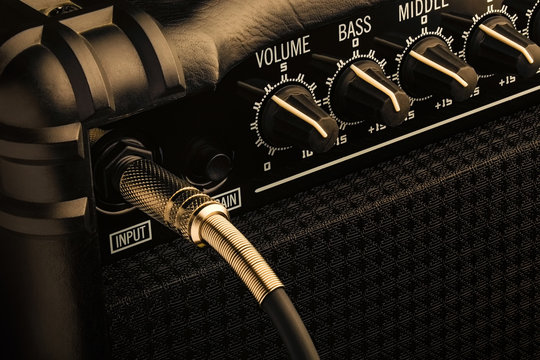 Guitar amplifier with jack plugged in. Close up macro view