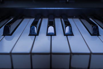 Piano keyboard background. Piano keys side view