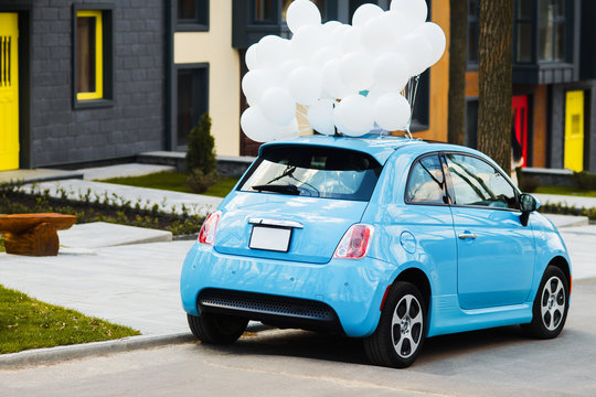 Blue car with white ballons. Wedding, birthday, party style concept