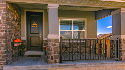 Home with stone brick wall and halloween decoration at the entrance
