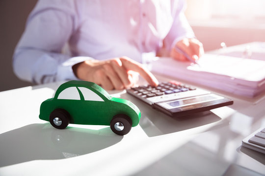 Close-up Of Car In Front Of Accountant