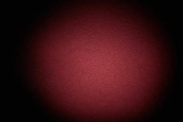 Volumetric textural cloud of burgundy light on a black background