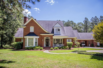 Large Red Brick Traditional Colonial Home House on a large Wooded lot in the south Fototapete