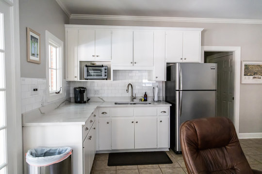 Small White Kitchen in a Cottage Apartment Pool House