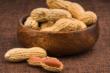dried  peanuts with shell on white background