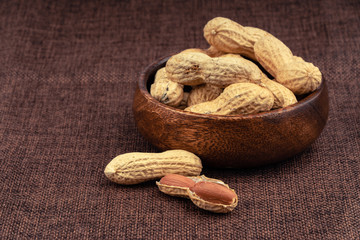 dried  peanuts with shell on jute background