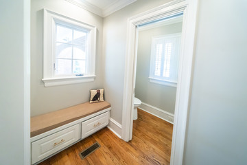 Spacious mudroom in a home with a bench
