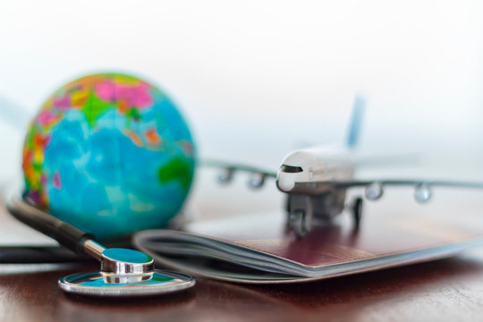 Healthcare and travel insurance concept. Stethoscope , passport document, airplane and globe
